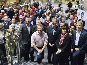 Councillors Jody Mitic (left), Bob Monette, Tim Tierney, Mayor Jim Watson, MPP Marie-France Lalonde and MP Andrew Leslie celebrated the new year with members of the community, pictured in behind of them, at the Shenkman Arts Centre on Jan. 4. Brier Dodge/Metroland